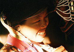 BURMA (MYANMAR), Shan State, Peinnebin. 2006. Allowing herself some time to smile, Ma Ko is surrounded by assistants preparing her elaborate Palaung wedding headdress.