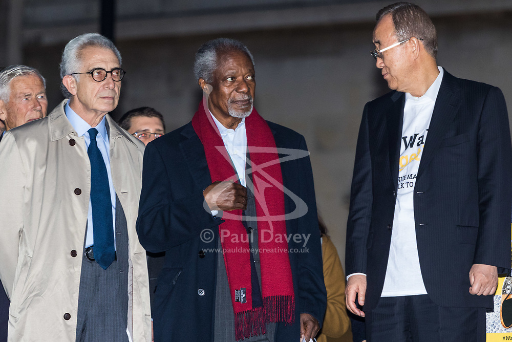 "London, October 23 2017. Nelson Mandela's group of Elders including former UN Secretary General Kofi Annan and Secretary General Ban Ki-moon accompanied by his widow Graca Machel gather at Parliament Square at the start of the Walk Together event in memory of Nelson Mandela before a candlelight vigil at his statue in Parliament Square. ""WalkTogether is a global campaign to inspire hope and compassion, celebrating communities working for the freedoms that unite us"". PICTURED:  kofi Annan, centre, Ban Ki-Moon (right) and Lakhdar Brahimi. © Paul Davey"