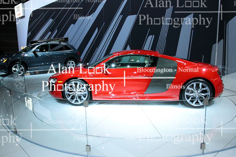 11 February 2009: 2009 AUDI R8: Incorporating the name and the genes of the five-time Le Mans winner, the Audi R8 is a spectacular production two-seater. This is the first production Audi mid-engine sports car, featuring a 420 horsepower, 4.2-liter V-8 FSI engine. For '09 a six disc CD player, Bluetooth and Homelink are added to the long standard equipment list. Available are high gloss 19-inch alloy wheels, just in case you want to show off even more. The R8 comes with Quattro permanent all-wheel-drive, an aluminum body and Audi Space Frame. Behind the doors, a large 'sideblade' air deflector sweeps between the wheel arch and the roof section, and delivers air for the V-8 to breathe as well as for cooling. An automatically extending rear spoiler is deployed to assist the R8 by using the wind. Estimated top speed is 187 mph, and this Audi can blast from 0 to 60 mph in 4.1 seconds.. The Chicago Auto Show is a charity event of the Chicago Automobile Trade Association (CATA) and is held annually at McCormick Place in Chicago Illinois.