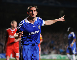 Frank Lampard celebrates scoring for Chelsea during the UEFA Champions League Quarter Final Second Leg match between Chelsea and Liverpool at Stamford Bridge on April 14, 2009 in London, England.