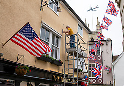© Licensed to London News Pictures. 16/05/2018. Windsor, UK. A man repaints the sign on The Prince Harry Pub in Windsor ahead of the Royal Wedding. Prince Harry and Meghan Markle are to be married on Saturday in Windsor. Photo credit: Rob Pinney/LNP