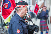 Pipers warm up - The Fire Brigades Union holds a protest rally and marc.  Stating at Methodist Central Hall and then heading for Parliament. They are demanding a farer pension settlement and a rethink of the increased retirement age. They accuse Penny Mordaunt, the minister responsible, of lieing to them about the changes and their impact. Westminster London, UK 25 Feb 2015.