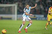 Jamie Paterson (Huddersfield Town) passes the ball to the wing during the Sky Bet Championship match between Huddersfield Town and Rotherham United at the John Smiths Stadium, Huddersfield, England on 15 December 2015. Photo by Mark P Doherty.