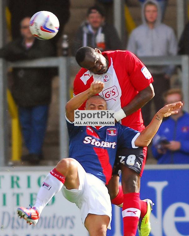 Claude Davis (Crawley Town, red) heads clear from Danny Cadamarteri. .Carlisle v Crawley, Npower League One, 29th September 2012..(c)  Alex Todd | StockPix.eu