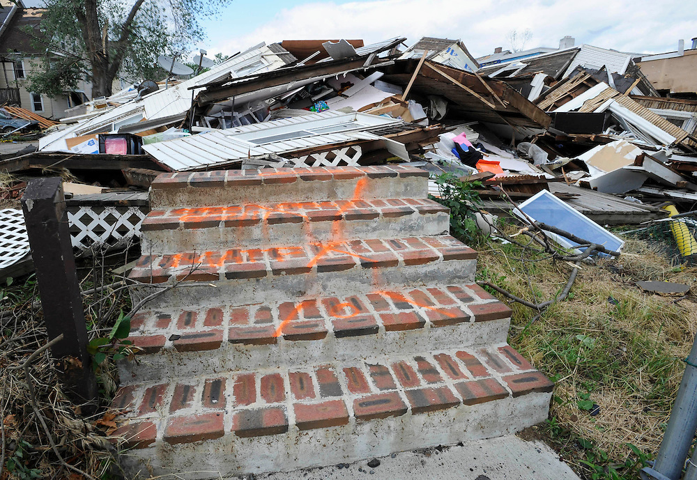 Stairs lead to the destroyed home of Angelica Guerrero in West Springfield, Mass., Thursday, June 2, 2011.  Guerrero was killed shielding her daughter in the bathtub when a tornado hit Wednesday.  (AP Photo/Jessica Hill)