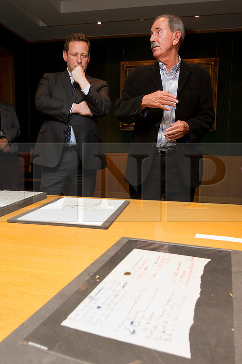 """© Licensed to London News Pictures. 22/05/2013. London, UK. British Minister for Culture, Ed Vaizey (L), and acclaimed Beatles biographer, Hunter Davies, are seen over the original lyrics for the Beatles song 'Strawberry Fields' at the British Library in London today (22/05/2013). The lyrics, along with others and letters between Mr Davies and the late John Lennon, were presented to the library under the """"lifetime giving"""" scheme. Photo credit: Matt Cetti-Roberts/LNP"""