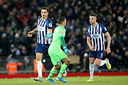 Brighton and Hove Albion defender Lewis Dunk (5) celebrates his goal 2-1  during the Premier League match between Liverpool and Brighton and Hove Albion at Anfield, Liverpool, England on 30 November 2019.