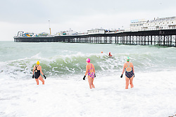 © Licensed to London News Pictures. 13/01/2018. Brighton, UK. Members of the Brighton Swimming Club brave the powerful waves and cold water temperatures to go for their daily exercise. Photo credit: Hugo Michiels/LNP