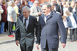 Image licensed to i-Images Picture Agency. 28/06/2014. West Belfast,United Kingdom. Fellow Guildford Four members Paddy Armstrong (R) and Paddy Hill (L) arrive for the funeral of Gerry Conlon at St Peter's Cathedral, West Belfast,Northern Ireland, United Kingdom,<br />  Picture by  i-Images
