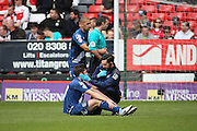 Birmingham City midfielder, Jon Toral (20) looked at by physio during the Sky Bet Championship match between Charlton Athletic and Birmingham City at The Valley, London, England on 2 April 2016. Photo by Matthew Redman.
