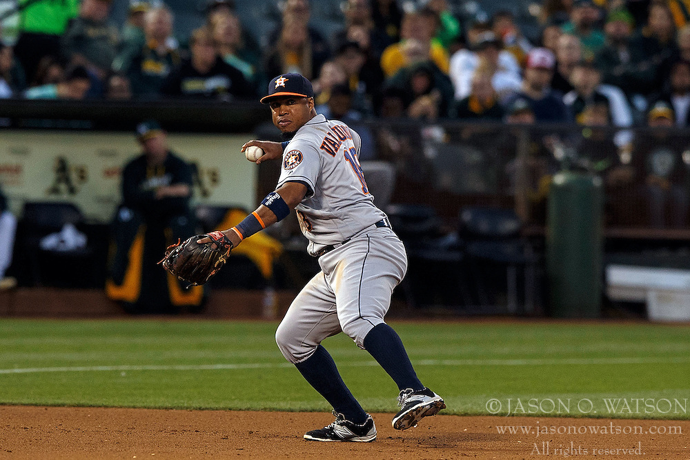 OAKLAND, CA - JULY 19:  Luis Valbuena #18 of the Houston Astros throws to first base against the Oakland Athletics during the fourth inning at the Oakland Coliseum on July 19, 2016 in Oakland, California. The Oakland Athletics defeated the Houston Astros 4-3 in 10 innings.  (Photo by Jason O. Watson/Getty Images) *** Local Caption *** Luis Valbuena