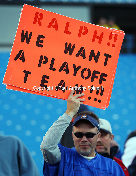A Buffalo Bills fan holds up a sign telling the team owner that he wants a playoff team during the NFL football game against the Houston Texans, November 1, 2009 in Orchard Park, New York. The Texans won the game 31-10. (©Paul Anthony Spinelli)
