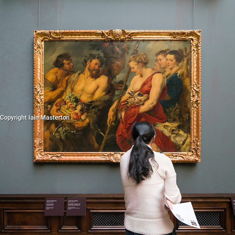 "Visitor looking at  painting ""Diana Returning from the Hunt""  by Peter Paul Rubens at Gemäldegalerie Alte Meister or Zwinger Museum in Dresden, Germany .Editorial Use Only."