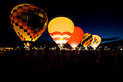 Crowds gather to watch the Dawn Patrol at the Albuquerque International Balloon Fiesta