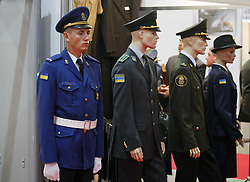 October 9, 2018 - Kiev, Ukraine - An Ukrainian soldier stands next to mannequins in uniforms at the ''Arms and Security 2018'' exhibition in Kiev, Ukraine, 09 October 2018. The exhibition presents armament segments and means of individual equipment of a soldier on the battlefield,equipment and armament of ground forces,weapons and equipment of law enforcement agencies,facilities of border control and military aviation, and will take place in Kiev from 09 to 12 October 2018. (Credit Image: © Str/NurPhoto via ZUMA Press)