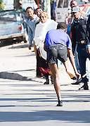 22/11/2015  repro fee.  A group of 25 from Gorta-Self Help Africa travelled to the capital of Ethiopia Addis Ababa for the great Ethiopian run which is Ethiopia's Haile Gebrselassie last race seen here taking off his runners to  run bare foot for the last KM  .  In temperatures in the mid 30 degree heat and 40,000 people and a city at 7,500 feet above sea level, it&rsquo;s no mean feat.   Photo:Andrew Downes <br /> <br /> <br /> <br /> <br /> Pics to be used with Gorta - Self Help Arica images only