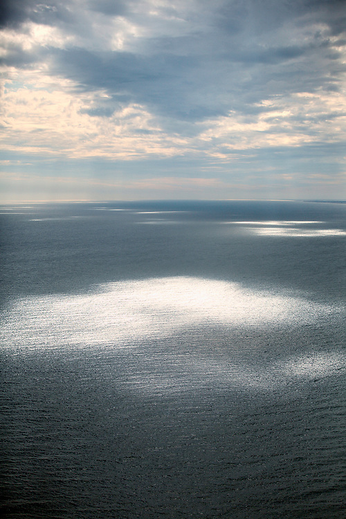 WRIGHTSVILLE BEACH, NC - Light beams shine through cloudy skies in these aerial photographs of beach scenes.
