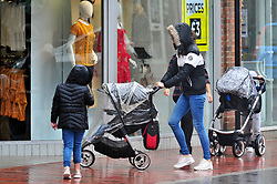 © Licensed to London News Pictures. 09/08/2018<br /> Tonbridge, UK. Raincoats on for shoppers in Tonbridge High Street, Tonbridge, Kent as the heatwave across the south east comes to an end.<br /> Photo credit: Grant Falvey/LNP