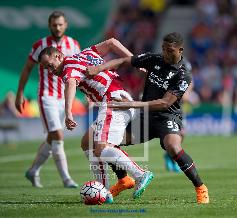 Charlie Adam of Stoke City (left) shields the ball from Jordon Ibe of Liverpool during the Barclays Premier League match at the Britannia Stadium, Stoke-on-Trent<br /> Picture by Russell Hart/Focus Images Ltd 07791 688 420<br /> 09/08/2015