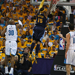 25 April 2009: Denver Nuggets forward Carmelo Anthony (15) dunks past New Orleans Hornets forward David West (30) during a NBA Western Conference quarter-finals playoff game between the New Orleans Hornets and the Denver Nuggets at the New Orleans Arena in New Orleans, Louisiana.
