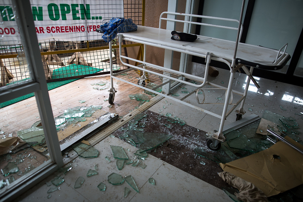 MARAWI, PHILIPPINES - JUNE 12: A view of an abandoned hospital damaged main entrance after a heavy fight, as government soldiers continue their assault against the Maute group, in Marawi City, Philippines June 12, 2017.  (Photo: Richard Atrero de Guzman/NUR Photo)