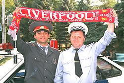 VLADIKAVKAZ, RUSSIA - Monday, September 11, 1995: Two Russian policemen hold aloft a Liverpool FC scarf before the UEFA Cup 1st Round 1st Leg match against FC Alania Spartak Vladikavkaz. (Photo by David Rawcliffe/Propaganda)