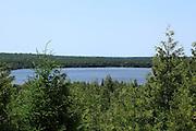 Chain Lake, near St. Ignace in Michigan's Upper Peninsula, offers some very picturesque scenery. Far in the distance, at the horizon, is Lake Michigan.