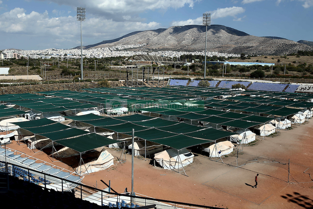October 5, 2016 - Athens, Greece - UNHCR tents set in the former Helliniko Olympic complex of Athens, Greece on October 5, 2016.Almost 2,500 migrants and refugees, mainly Afghani, are housed at the former Athens airport site, and to an olympic complex used in the 2004 Olympics. In total 60.736 refugees and other migrants are stranded in Greece. (Credit Image: © Panayiotis Tzamaros/NurPhoto via ZUMA Press)