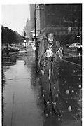 58/5th Avenue, man in the rain, New York 1992© Copyright Photograph by Dafydd Jones 66 Stockwell Park Rd. London SW9 0DA Tel 020 7733 0108 www.dafjones.com