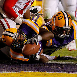 November 12, 2011; Baton Rouge, LA, USA;  LSU Tigers running back Kenny Hilliard (27) scores a touchdown against the Western Kentucky Hilltoppers during the second quarter of a game at Tiger Stadium.  Mandatory Credit: Derick E. Hingle-US PRESSWIRE