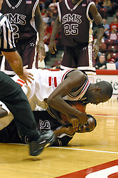 Baboucarr Bojang lands on an opponent on a held ball call.