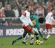POZNAN 17/11/2010.FOOTBALL INTERNATIONAL FRIENDLY.POLAND v IVORY COAST.Adrian Mierzejewski of Poland and Gervais Kouassi of Ivory Coast ..Fot: Piotr Hawalej / WROFOTO