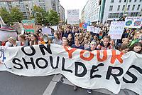 """20 SEP 2019, BERLIN/GERMANY:<br /> Demonstratinnen mit Transparent """"OUR FUTURE ON YOUR SHOULDERS"""", Fridays for Future Demonstration für Massnahmen zur  Begrenzung des Klimawandels, Behrenstrasse<br /> IMAGE: 20190920-01-035<br /> KEYWORDS: Demo, Demonstrant, Protest, Protester, Demonstration, Klima, climate, change, Maedchen, Mädchen, Frauen, Schueler, Schuelerinnen, Schüler, Schülerinnen"""