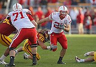 November 06 2010: Nebraska Cornhuskers running back Rex Burkhead (22) tries to pull away from Iowa State Cyclones defensive end Jacob Lattimer (48) during the second half of the NCAA football game between the Nebraska Cornhuskers and the Iowa State Cyclones at Jack Trice Stadium in Ames, Iowa on Saturday November 6, 2010. Nebraska defeated Iowa State 31-30.