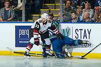 KELOWNA, BC - SEPTEMBER 29:  Alex Goligoski #33 of the Arizona Coyotes checks Troy Stecher #51 of the Vancouver Canucks into the boards at Prospera Place on September 29, 2018 in Kelowna, Canada. (Photo by Marissa Baecker/NHLI via Getty Images)  *** Local Caption *** Alex Goligoski;Troy Stecher