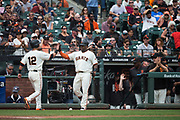 San Francisco Giants second baseman Joe Panik (12) high fives San Francisco Giants third baseman Pablo Sandoval (48) after scoring a run against the Colorado Rockies at AT&T Park in San Francisco, California, on September 20, 2017. (Stan Olszewski/Special to S.F. Examiner)