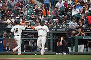 San Francisco Giants second baseman Joe Panik (12) high fives San Francisco Giants third baseman Pablo Sandoval (48) after scoring a run against the Colorado Rockies at AT&T Park in San Francisco, California, on September 20, 2017. (Stan Olszewski/Special to S.F. Examiner)