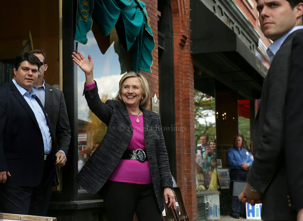 (Exeter, NH - 5/22/15) Former Secretary of State and presidential candidate Hillary Clinton waves to a crowd on Water Street in Exeter as she departs a campaign stop, Friday, May 22, 2015. Staff photo by Angela Rowlings.