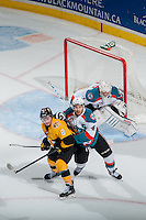 KELOWNA, CANADA - MAY 13: Madison Bowey #4 of Kelowna Rockets checks Jayce Hawryluk #8 of Brandon Wheat Kings during second period in front of the net of Jackson Whistle #1 of Kelowna Rockets on May 13, 2015 during game 4 of the WHL final series at Prospera Place in Kelowna, British Columbia, Canada.  (Photo by Marissa Baecker/Shoot the Breeze)  *** Local Caption *** Jackson Whistle; Madison Bowey; Jayce Hawryluk;