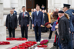 © Licensed to London News Pictures. 25/04/2019. London, UK. Foreign and Commonwealth Secretary Jeremy Hunt (centre) lays a wreath at The Cenotaph on Whitehall to mark Anzac Day. Photo credit : Tom Nicholson/LNP