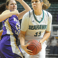 UNCW's Sarah Myatt drives against Western Carolina's Emily Hatfield Saturday November 29, 2014 at Trask Coliseum in Wilmington, N.C. (Jason A. Frizzelle)
