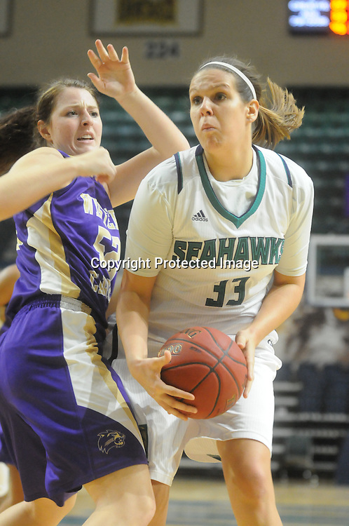 UNCW's Sarah Myatt drives against Western Carolina's Emily Hatfield Saturday November 29, 2014 at Trask Coliseum in Wilmington, N.C. (Jason A. Frizzelle)