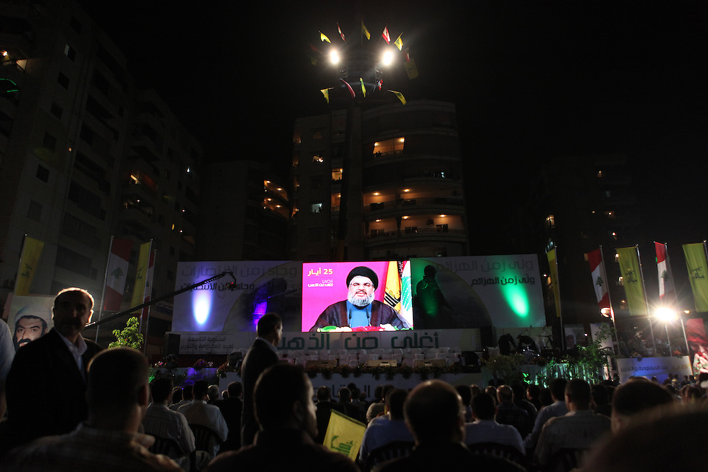Supporters of the Shiite resistance and political group, Hizballah, rallied in the Dahiyeh southern suburbs of Beirut to watch a televised speech from Hizballah General Secretary Hassan Nasrallah. The rally was called for by Hizballah to celebrate Land Day, which is the 9th anniversary of Israel's withdrawal from southern Lebanon, which Hizballah and its supporters say was a victory over Israel. The rally comes just 13 days before Lebanese go to the polls to elect a new parliament. With Sunni Muslims and Shia Muslims mostly supporting their respective sectarian parties, Nasrallah praised Christian leader Michel Aoun. Aoun is head of the Free Patriotic Movement, which is allied with the Hizballah-led opposition March 8 coalition. ///Hizballah Secretary General Hassan Nasrallah delivers his televised speech.