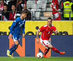 30.05.2014, Tivoli Stadion, Innsbruck, AUT, Fussball Testspiel, Oesterreich vs Island, im Bild (v.l.) Rurik Gislason (ISL), Marko Arnautovic (AUT) // Rurik Gislason (ISL) (L) in action against Marko Arnautovic (AUT) (R) during the International Friendly between Austria and Iceland at the Tivoli Stadion in Innsbruck, Austria on 2014/05/30. EXPA Pictures © 2014, PhotoCredit: EXPA/ Johann Groder