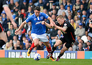Portsmouth defender Enda Stevens takes on Carlisle United Defender Tom Miller during the Sky Bet League 2 match between Portsmouth and Carlisle United at Fratton Park, Portsmouth, England on 2 April 2016. Photo by Adam Rivers.