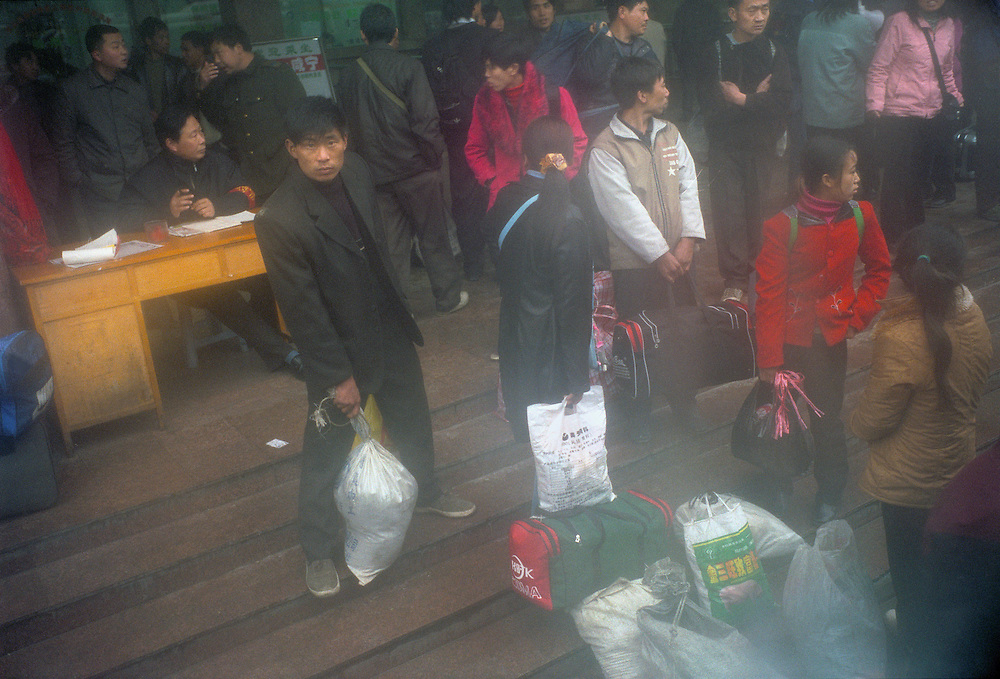 Migrant worker and travellers. Boat services to Yichang are disrupted due to the completion of the dam. the last section of the journey has been replaced by bus services.