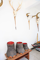 Elephant's feet umbrella stands and skulls on display at the Independence Palace, Ho Chi Minh City, Vietnam