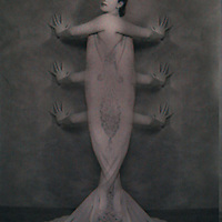 A woman with six arms appearing like a fish
