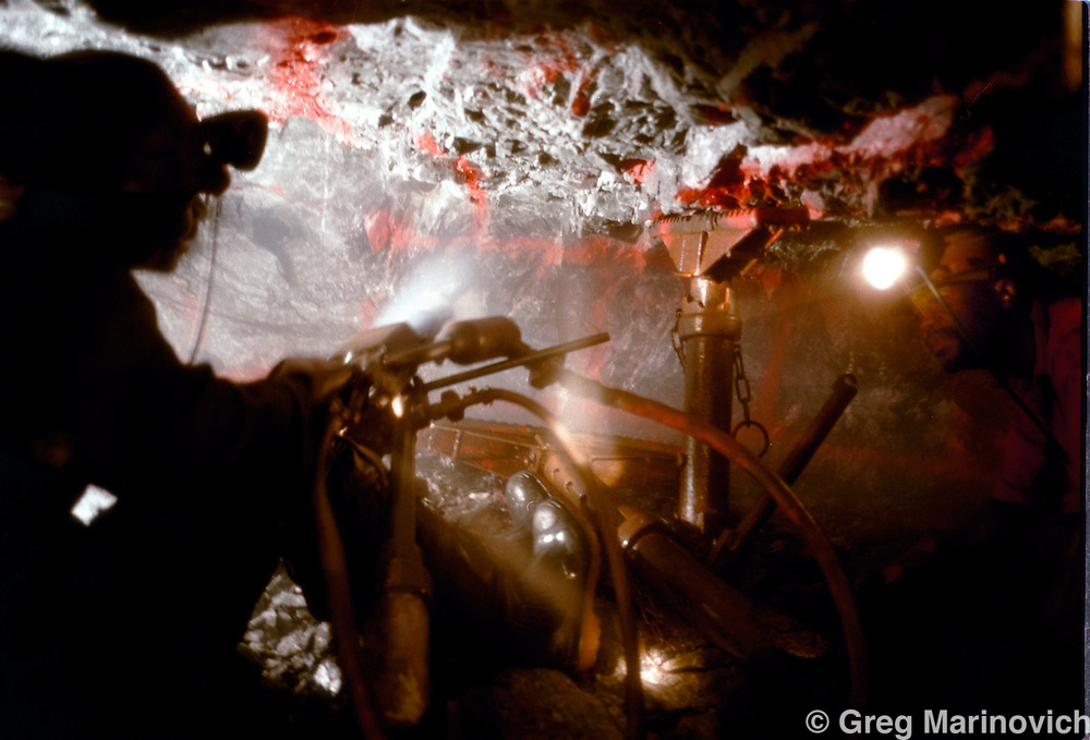 IPMG0391 South Africa, Western Deep, 2000: .Gold miner Samson X.  drills into the gold bearing ore kilometres underground in the world's deepest mine at four km - Savuka (formerly Western Deep levels east) owned by AngloGold, May, 2000. .Photograph by Greg Marinovich