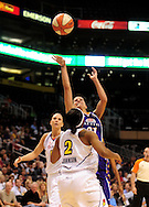 June 4, 2010; Phoenix, AZ, USA; Los Angeles Sparks guard Ticha Penicheiro makes a shot against Phoenix Mercury guard Temeka Johnson during the first half in at US Airways Center.  Mandatory Credit: Jennifer Stewart-US PRESSWIRE
